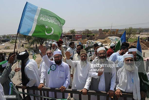 Syed Munawar Hassan Ameer of Jama'ateIslami and other leaders waves to supporters during a protest in Jamrud on July 17 2012 Thousands of Pakistani...