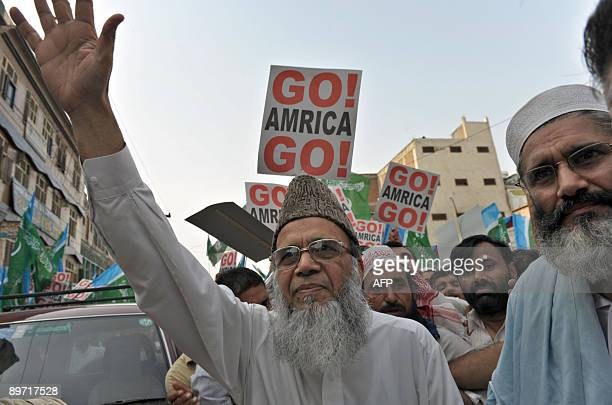 Syed Munawar Hassan Ameer of JamaateIslami waves to supporters upon arrival at an antiUS rally in Peshawar on August 9 against the US interference in...