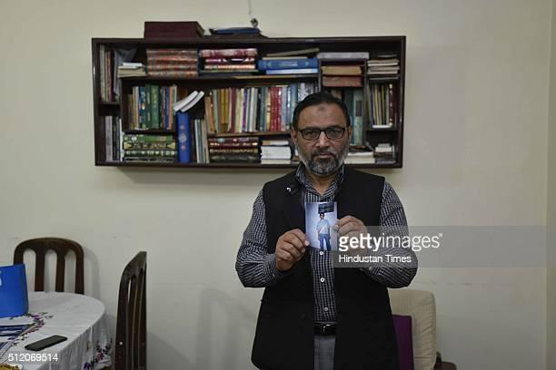 Syed Qasim Rasool Ilyas father of JNU student Umar Khalid showing his picture wearing Indian cricket team jersey at his residence at Zakir Nagar on...