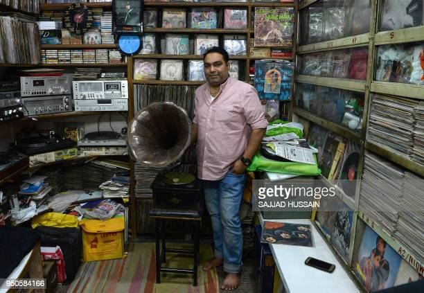 Syed Zafar Shah who runs a gramophone repair operation poses at the Shah Music Centre store where he sells antique gramophones and vinyl records in...