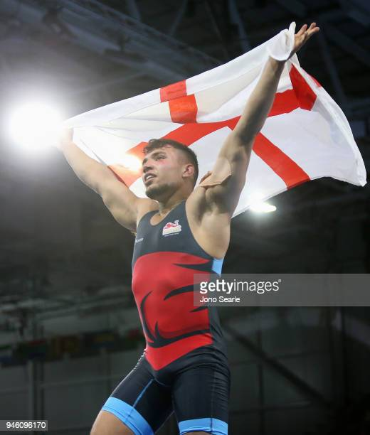 Syerus Eslami of England celebrates after winning bronze in the men's freestyle 86kg event during Wrestling on day 10 of the Gold Coast 2018...