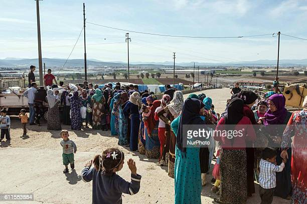 Syian refugees during a food distribution near Torbali Izmir Turkey June 2016 In the discrict of Izmir in the western part of Turkey live thousands...