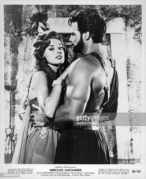 Sylva Koscina holding onto Steve Reeves in a scene from the film 'Hercules Unchained' 1959