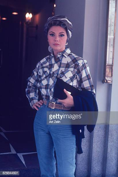 Sylva Koscina in jeans and a plaid shirt with curlers in her hair circa 1970 New York