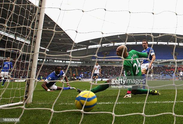 Sylvain Distin and Tim Howard of Everton can only look on as the shot by Marvin Sordell of Bolton Wanderers goes into the back of the net during the...