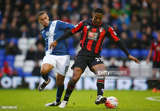 Sylvain Distin of Bournemouth and James Vaughan of Birmingham City compete for the ball during the Emirates FA Cup Third Round match between...