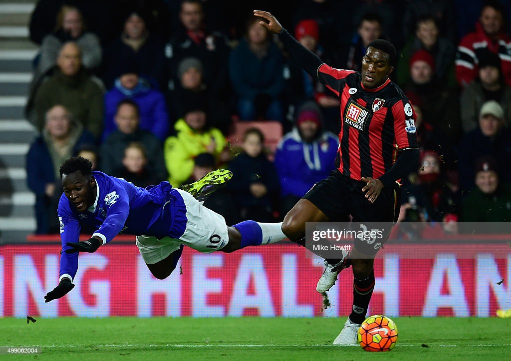 Sylvain Distin of Bournemouth and Romelu Lukaku of Everton compete for the ball during the Barclays Premier League match between A.F.C. Bournemouth and Everton at Vitality Stadium on November 28, 2015 in Bournemouth, England.