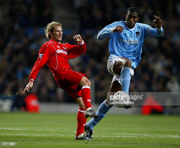 Sylvain Distin of City gets past Gaizka Mendieta of Middlesbrough during the FA Barclaycard Premiership match between Manchester City and...