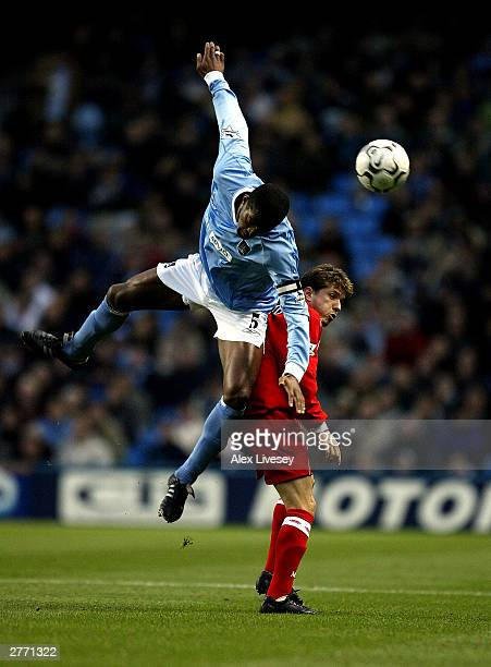 Sylvain Distin of City jumps over Juninho of Middlesbrough during the FA Barclaycard Premiership match between Manchester City and Middlesbrough at...