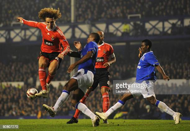Sylvain Distin of Everton blocks the shot of David Luiz of Benfica during the UEFA Europa League Group I match between Everton and Benfica at...