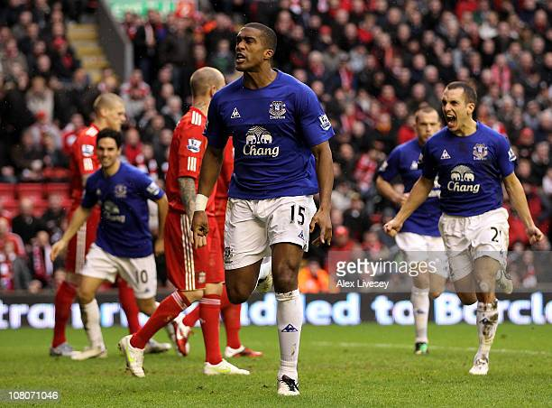 Sylvain Distin of Everton celebrates scoring his team's first goal during the Barclays Premier League match between Liverpool and Everton at Anfield...