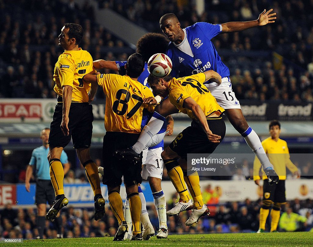 Sylvain Distin of Everton challenges Sanel Jahic of AEK Athens during the UEFA Europa League Group I match between Everton and AEK Athens at Goodison Park on September 17, 2009 in Liverpool, England.