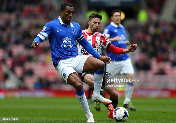 Sylvain Distin of Everton holds off a challenge from Fabio Borini of Sunderland during the Barclays Premier League match between Sunderland and...