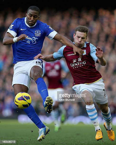 Sylvain Distin of Everton holds off Andreas Weimann of Aston Villa during the Barclays Premier League match between Everton and Aston Villa at...