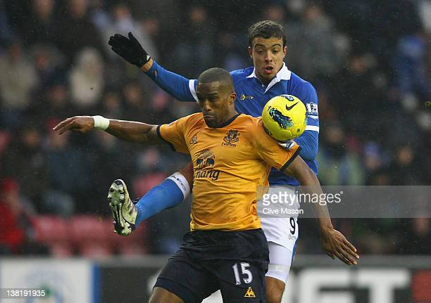 Sylvain Distin of Everton is challenged by Franco Di Santo of Wigan during the Barclays Premier League match between Wigan Athletic and Everton at DW...