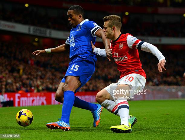 Sylvain Distin of Everton is marshalled by Jack Wilshere of Arsenal during the Barclays Premier League match between Arsenal and Everton at Emirates...