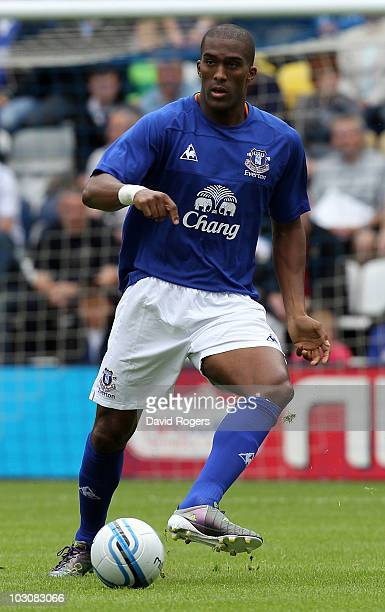Sylvain Distin of Everton passes the ball during the pre season friendly match between Preston North End and Everton at Deepdale on July 24, 2010 in...