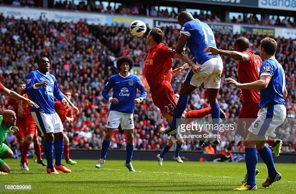 Sylvain Distin of Everton scores a disallowed goal during the Barclays Premier League match between Liverpool and Everton at Anfield on May 5 2013 in...