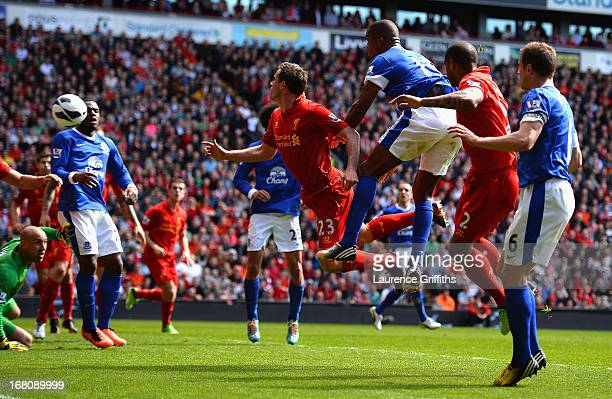Sylvain Distin of Everton scores a disallowed goal during the Barclays Premier League match between Liverpool and Everton at Anfield on May 5, 2013...
