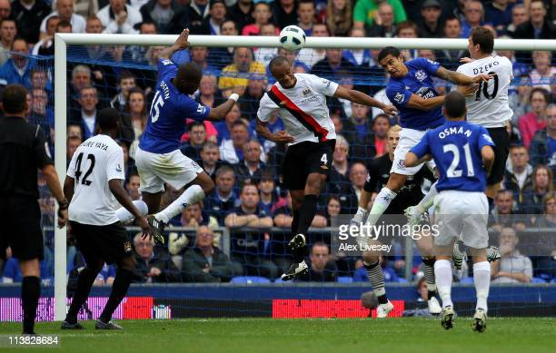 Sylvain Distin of Everton scores his team's first goal during the Barclays Premier League match between Everton and Manchester City at Goodison Park...