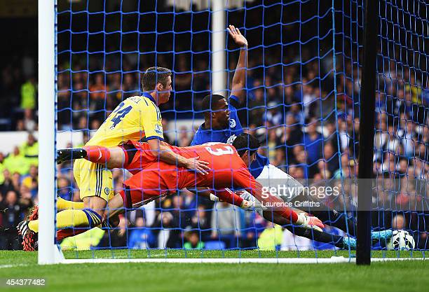 Sylvain Distin of Everton scores past Thibaut Courtois of Chelsea only for the goal to be ruled out during the Barclays Premier League match between...