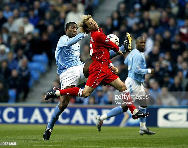 Sylvain Distin of Manchester City holds off Gaizka Mendieta of Middlesbrough during the FA Barclaycard Premiership match between Manchester City and...