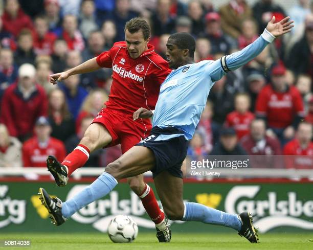 Sylvain Distin of Manchester City tackles Szilard Nemeth of Middlesbrough during the FA Barclaycard Premiership match between Middlesbrough and...