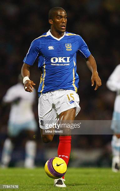 Sylvain Distin of Portsmouth runs with the ball during the Barclays Premier League match between Portsmouth and Manchester City at Fratton Park on...
