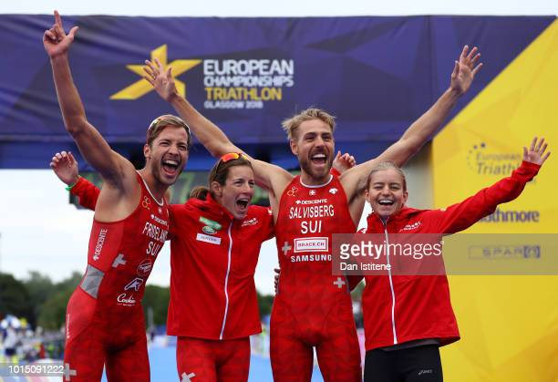 Sylvain Fridelance, Nicola Spirig, Andrea Salvisberg and Lisa Berger celebrates at the finish line after ending second during the Mixed Team Relay...