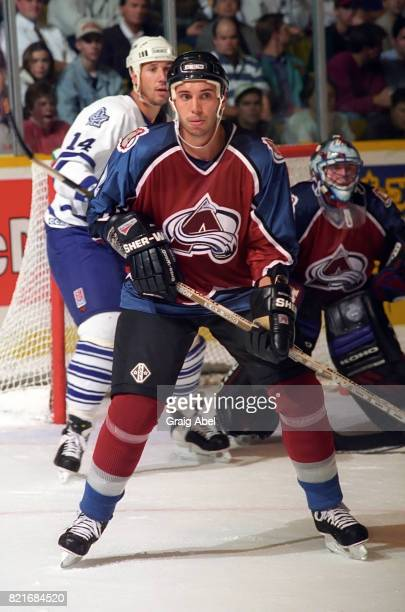 Sylvain Lefebvre of the Colorado Avalanche watches the play against the Toronto Maple Leafs during NHL preseason game action on September 27 1995 at...