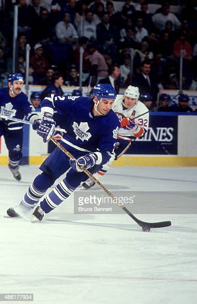 Sylvain Lefebvre of the Toronto Maple Leafs skates with the puck during an NHL game against the New York Islanders circa 1994 at the Nassau Coliseum...