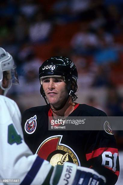 Sylvain Turgeon of the Ottawa Senators looks angry during an NHL game against the Hartford Whalers on April 3 1993 at the Hartford Civic Center in...