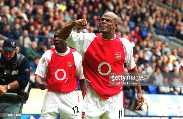 Sylvain Wiltord celebrates scoring a goal for Arsenal during the match between Bolton Wanderers and Arsenal on April 26, 2003 in Bolton, England.