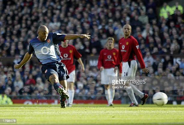 Sylvain Wiltord of Arsenal scores the second goal during the FA Cup fifth round match between Manchester United and Arsenal at Old Trafford...