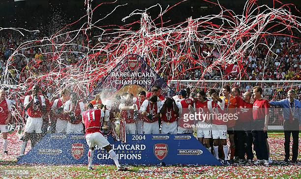 Sylvain Wiltord of Arsenal sprays his teammates with champagne as they celebrate winning the Premiership during the FA Barclaycard Premiership match...