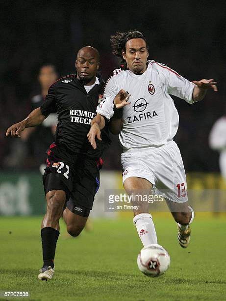 Sylvain Wiltord of Lyon battlles with Alessandro Nesta of AC Milan during the UEFA Champions League Quarter Final First Leg match between Lyon and AC...