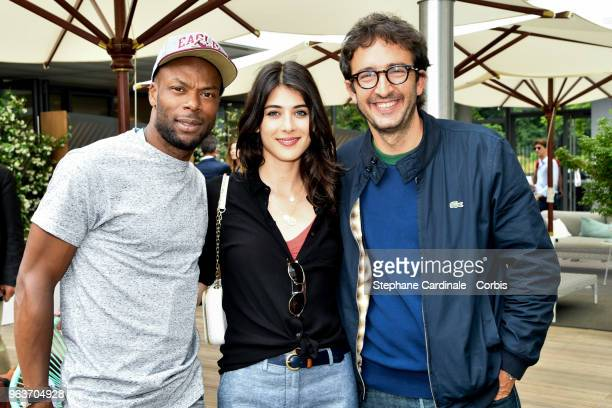 Sylvain Wiltord Sandrine Calvayrac and Cyrille Eldin attend the 2018 French Open Day Four at Roland Garros on May 30 2018 in Paris France