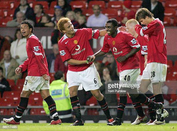 Sylvan EbanksBlake of Manchester United celebrates scoring their fourth goal with teammate Wes Brown during the Carling Cup third round match between...
