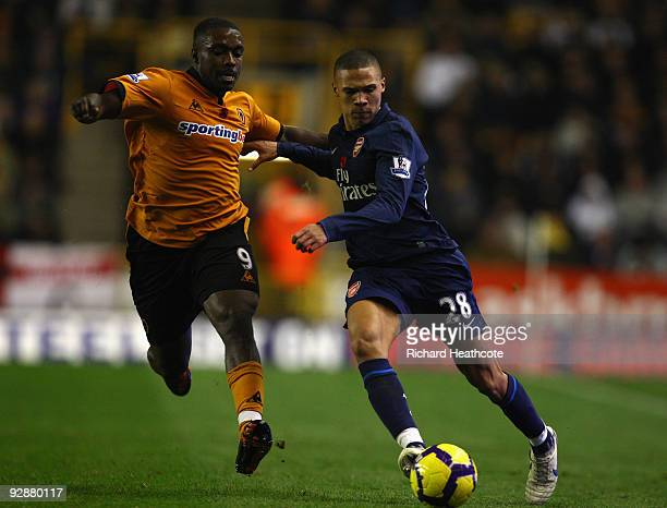 Sylvan EbanksBlake of Wolverhampton Wanderers competes for the ball with Kieran Gibbs of Arsenal during the Barclays Premier League match between...