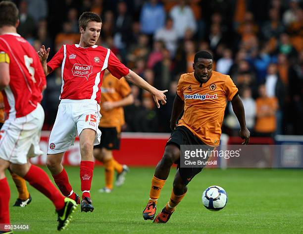 Sylvan EbanksBlake of Wolverhampton Wanderers in action with Josh O'Keefe of Walsall during the Pre Season Friendly match between Walsall and...