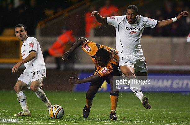 Sylvan EbanksBlake of Wolverhampton Wanderers is tackled by Ashley Williams of Swansea during the CocaCola Championship match between Wolverhampton...