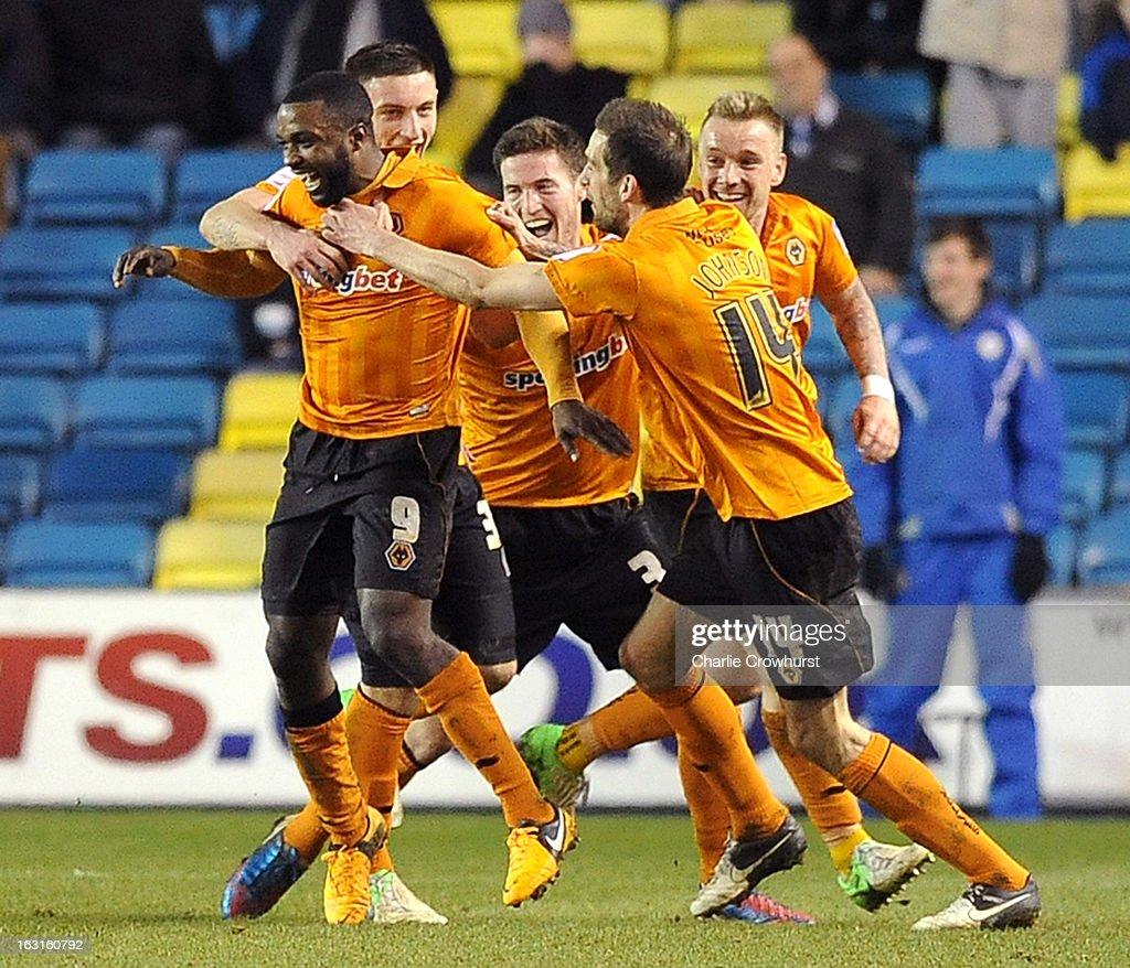 Sylvan Ebanks-Blake of Wolves (L) celebrates after he scores the teams second goal of the game during the npower Championship match between Millwall and Wolverhampton Wanderers at The Den on March 05, 2013 in London, England,