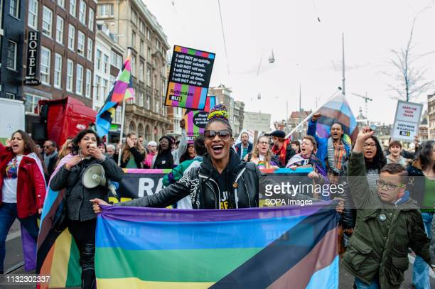 Sylvana Simons political leader of the political party in the Netherlands BIJ1 is seen holding an inclusive flag during the demonstration Thousands...