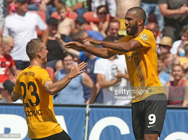 Sylvano Comvalius of Dresden jubilates with team mate David Vrzogic after scoring the third goal during the third league match between FC Energie...