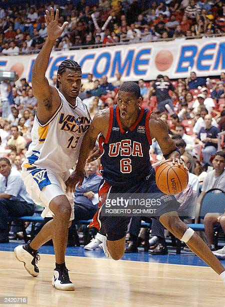 Sylvester Charles of the Virgin Islands guards Tracy McGrady of the US during their first round FIBA Americas Men's Olympic Basketball qualifying...