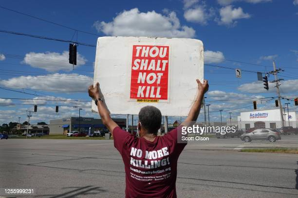 Sylvester Edwards expresses his opposition to the death penalty during a protest near the Federal Correctional Complex where Daniel Lewis Lee is...