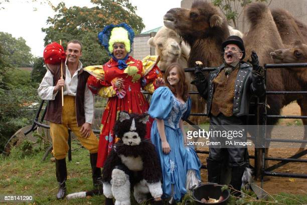 Sylvester McCoy as 'King Rat' and Cassandra Compton as 'Alice Fitzwarren' join other performers at a preview of the pantomime 'Dick Whittington and...