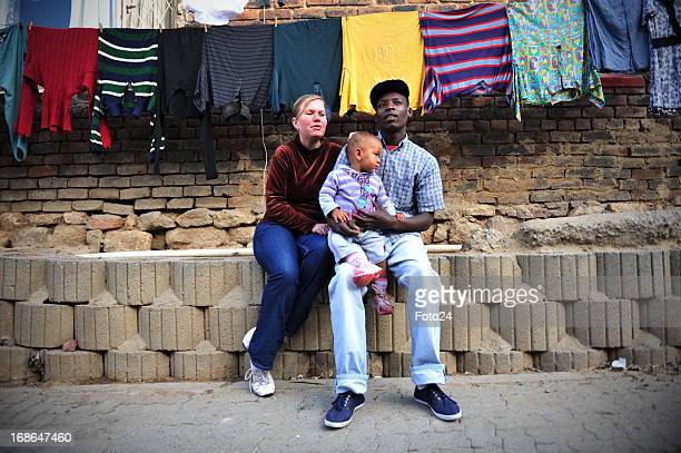 Sylvester Mmboyi with his fiance Cherene le Roux and their daughter Nkhensani on May 9 2013 in Alexandra township in Johannesburg South Africa The...