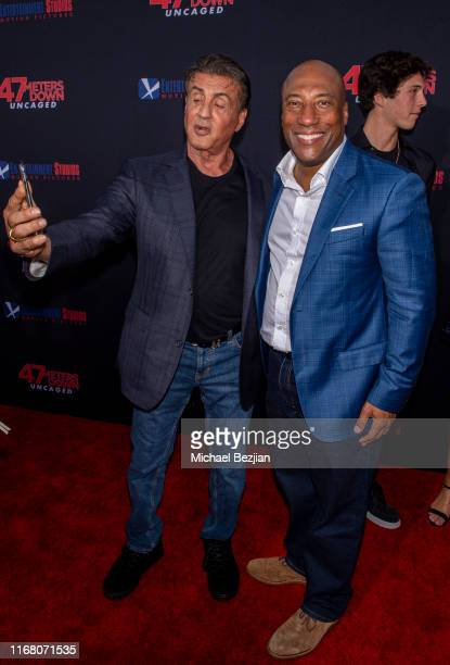 Sylvester Stallone and Byron Allen attend the LA Premiere of 47 Meters Down UNCAGED on August 13 2019 in Los Angeles California