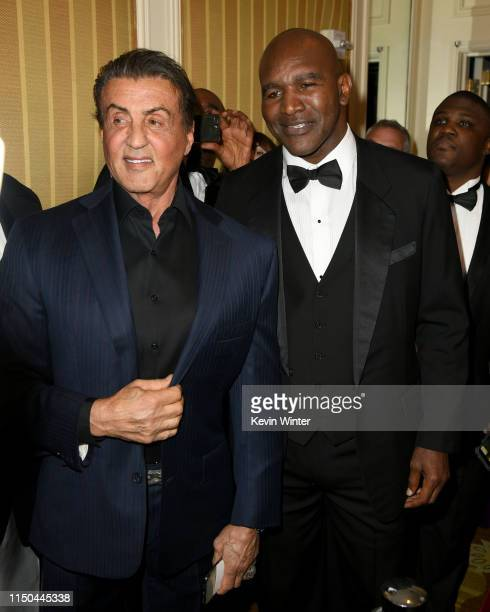 Sylvester Stallone and Evander Holyfield arrive at the American Icon Awards at the Beverly Wilshire Four Seasons Hotel on May 19 2019 in Beverly...